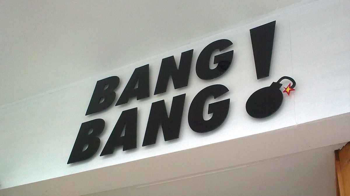 Black acrylic sign for a nightclub
